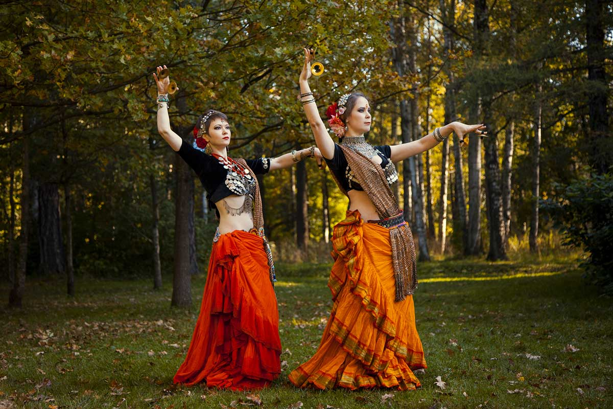 two girls taking belly dancing classes