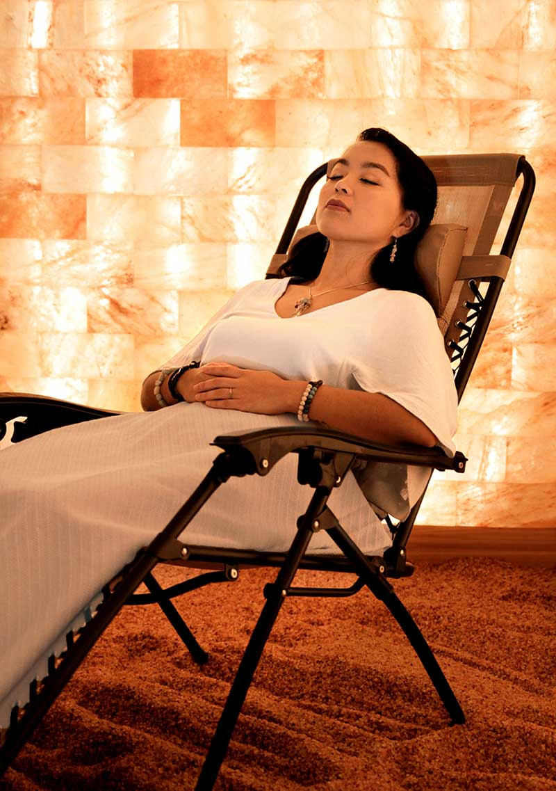 woman relaxing in salt room spring hill fl