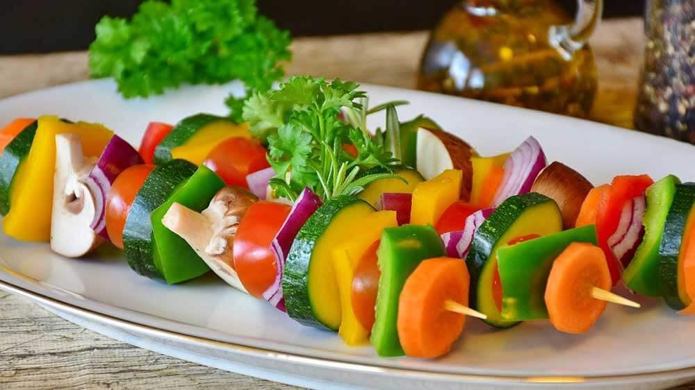 vegetable skewers on a plate