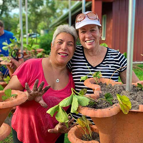 two women working on garden together